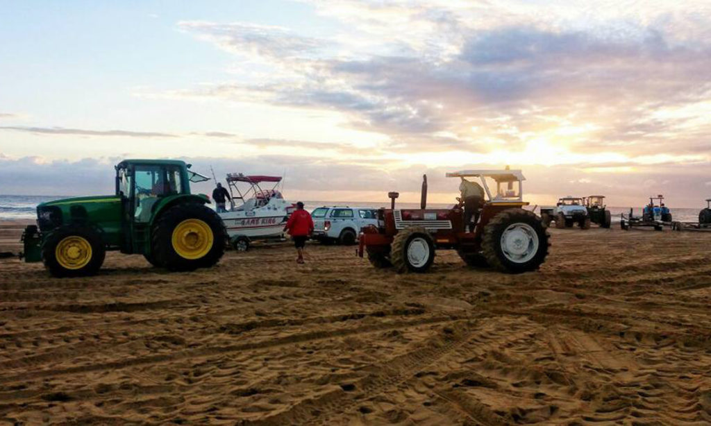 Tractors on the beach for boat launch at 41st OET Bill & Game Fish Tournament of MDSAA in Sodwana by Nauti-Tech Suzuki